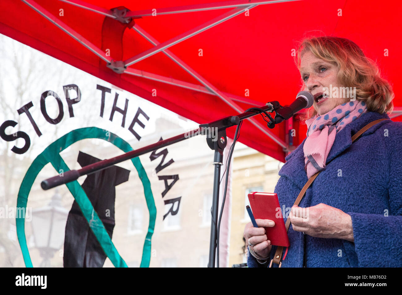 London, UK. 7th April, 2018. Jocelyn Hurndall, a human rights activist and mother of Tom Hurndall, who was shot in the head by an Israeli sniper in Gaza in 2003, addresses hundreds of people at a rally outside Downing Street in solidarity with Palestinians attending the Great March of Return in Gaza and in protest against the killing there by Israeli snipers using live ammunition of at least 27 unarmed Palestinians and the injury of hundreds more. Credit: Mark Kerrison/Alamy Live News Stock Photo