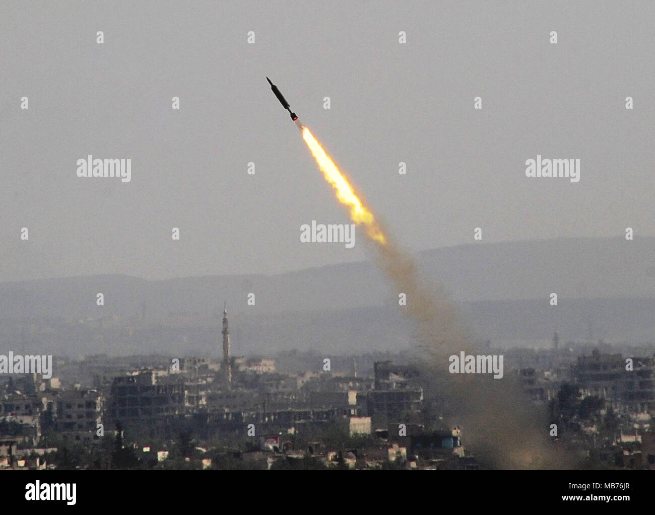 Damascus, Syria. 7th Apr, 2018. A rocket is seen launched by the Syrian army in Eastern Ghouta countryside of Damascus, Syria, on April 7, 2018. The Syrian army on Saturday stormed the frontlines of the Islam Army in the Douma district of the capital Damascus' Eastern Ghouta countryside, state news agency SANA reported. Credit: Ammar Safarjalani/Xinhua/Alamy Live News - Stock Image