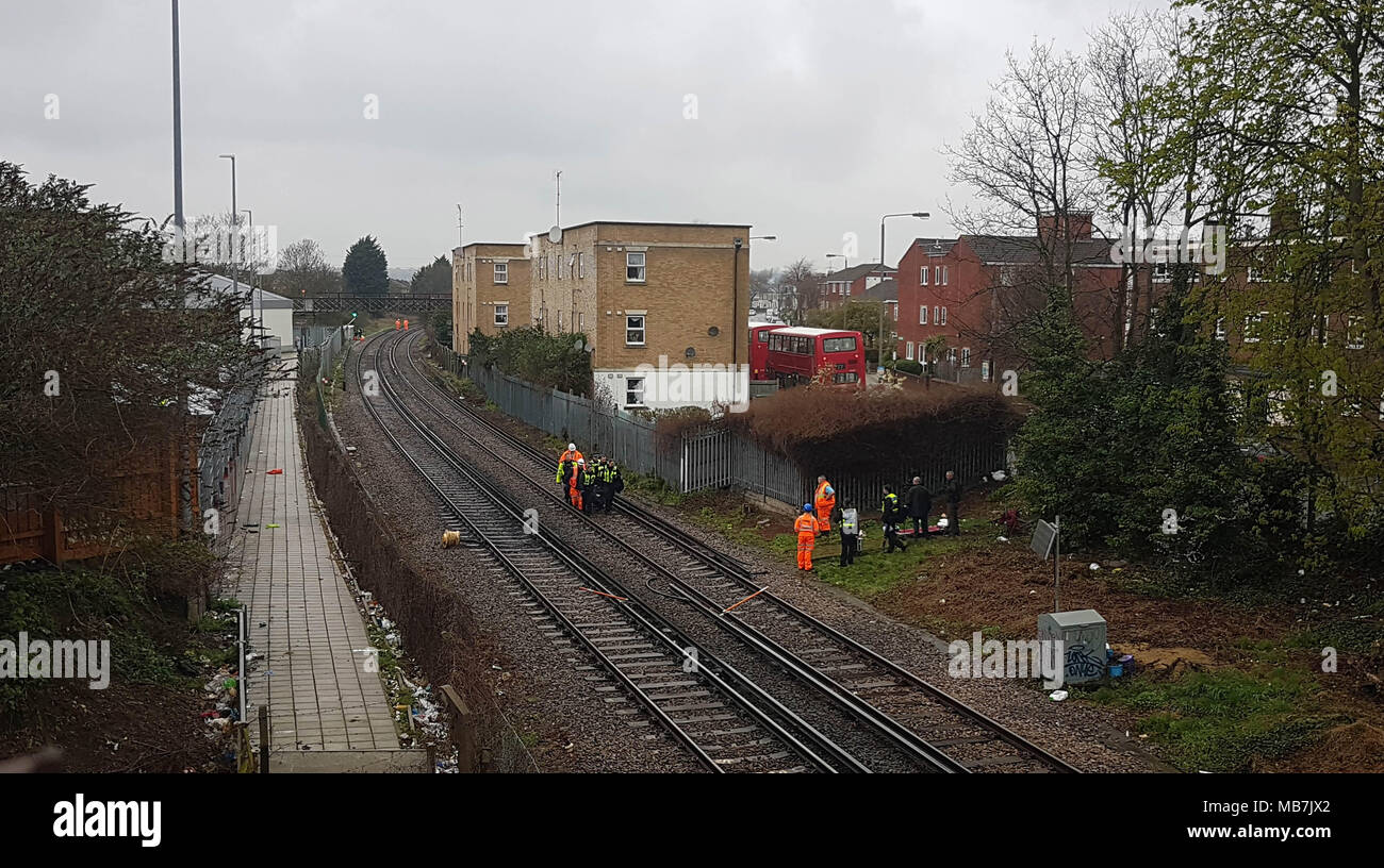 Tooting, South London, UK. 8th April, 2018. Body taken off railway line, Tooting, South London Credit: London Snapper/Alamy Live News Stock Photo