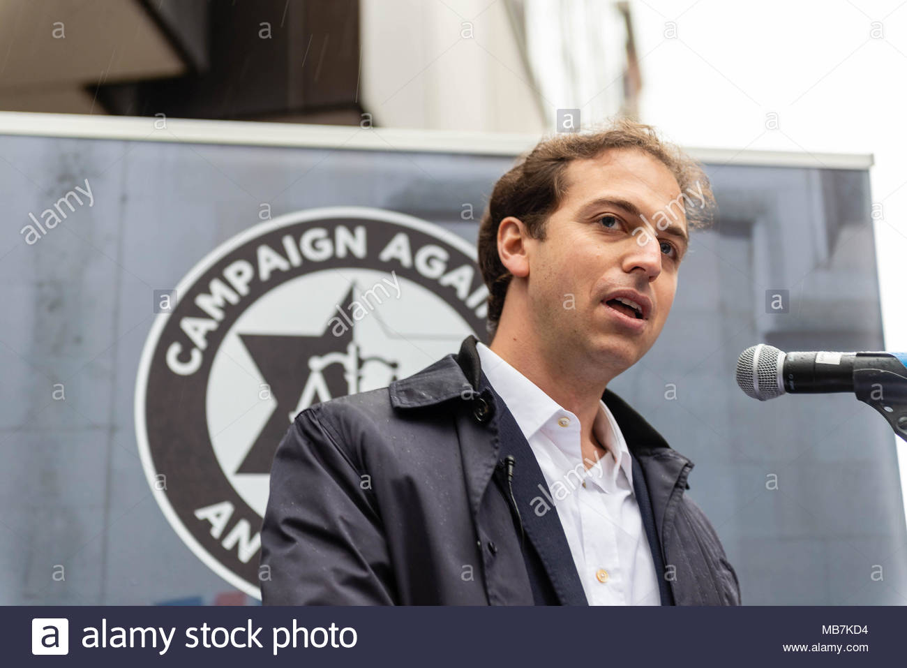 London, Great Britain, 08 April, 2018. Gideon Falter addressing the crowd. Hundreds of the UK's Jewish community and allies protested outside the Labour Party offices over the AntiSemitic crisis within the party and the4 lack of action to combat it. David Nash/Alamy Live News - Stock Image