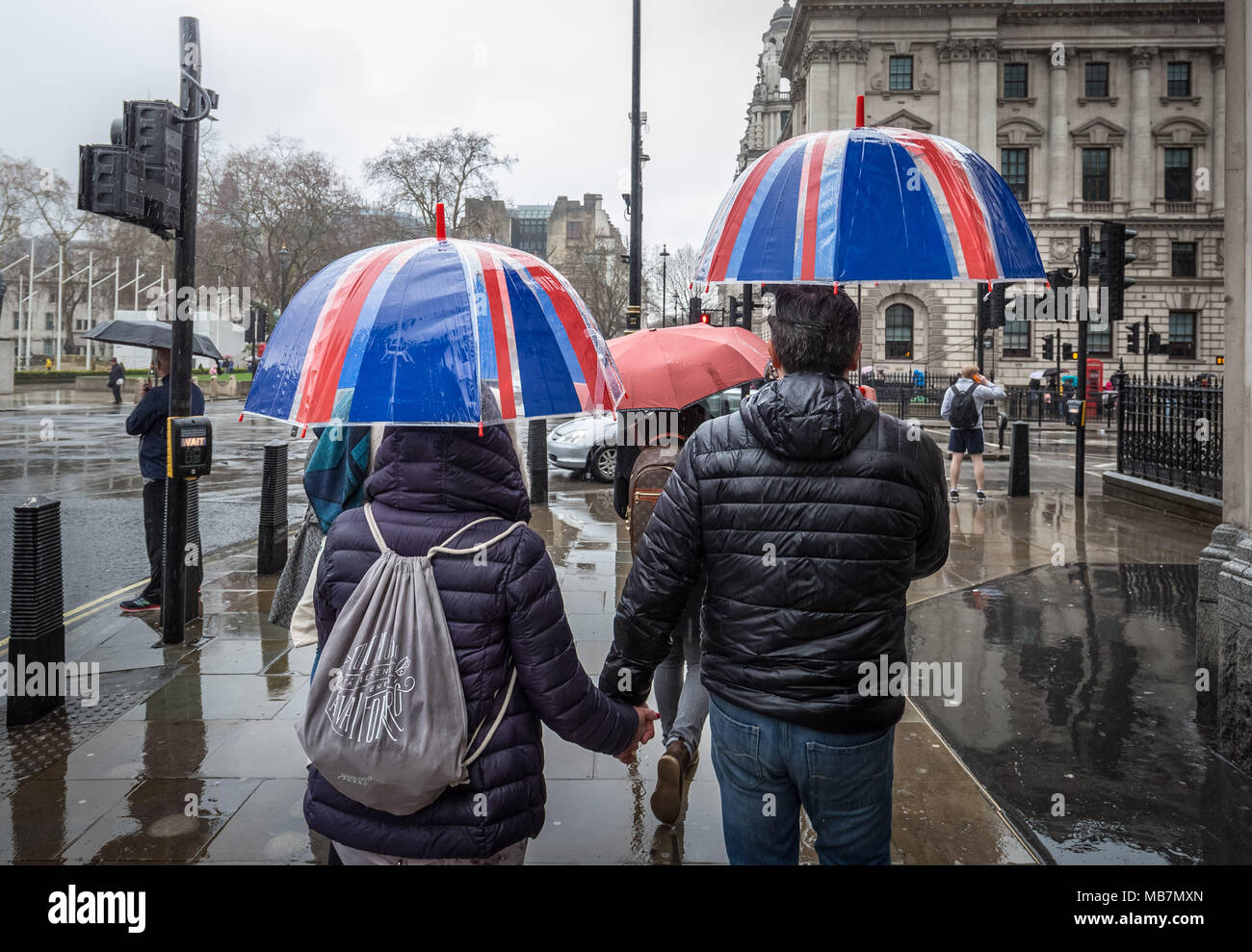London, UK. 8th April, 2018. UK Weather: Union flag umbrellas on a wet and rainy Sunday afternoon in Westminster. Credit: Guy Corbishley/Alamy Live News Stock Photo
