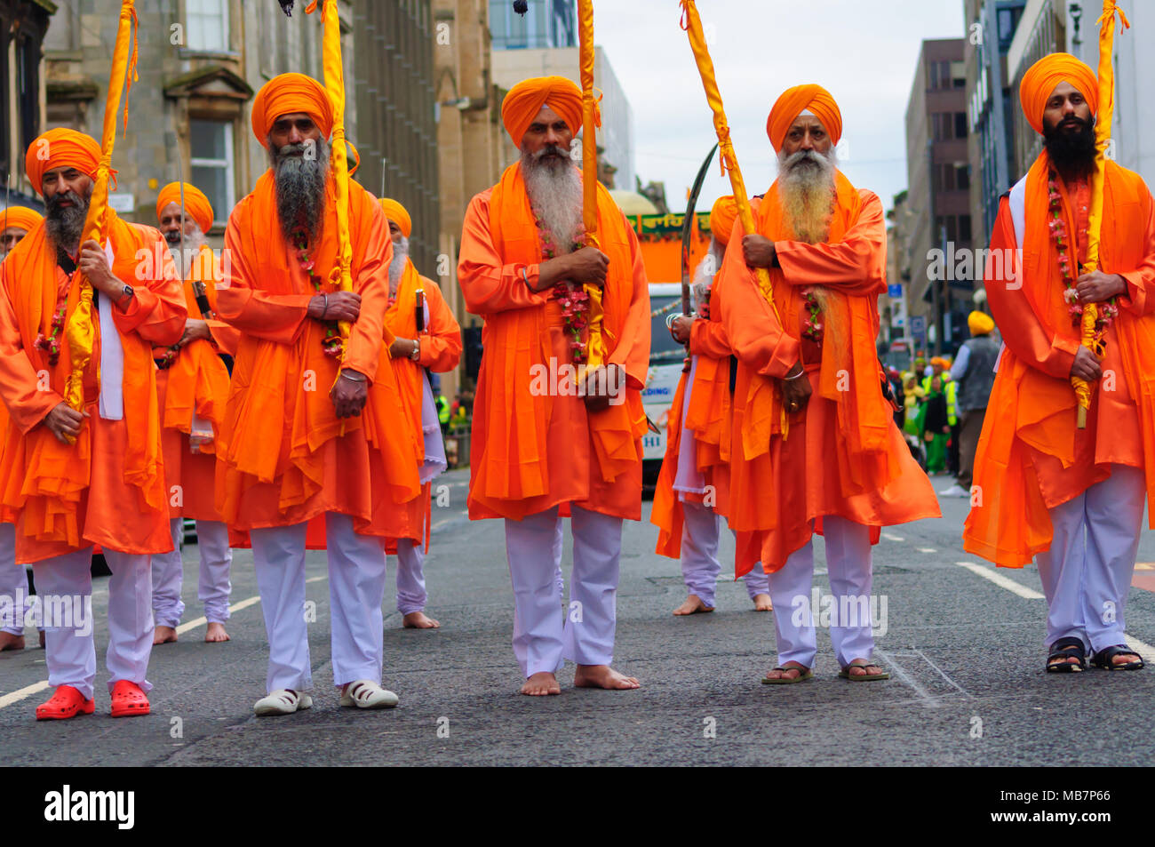 Glasgow, Scotland, UK. 8th April, 2018. The Sikh Festival of Vaisakhi is celebrated with the annual Nagar Kirtan, a spiritually centred community procession through the city. Today Sikhs participate in Seva which is selfless service. Each Gurdwara in the city provides Langar, a free community meal served to all visitors regardless of race, religion or social status, demonstrating the Sikh values of equality, humanity, justice and compassion. Credit: Skully/Alamy Live News Stock Photo