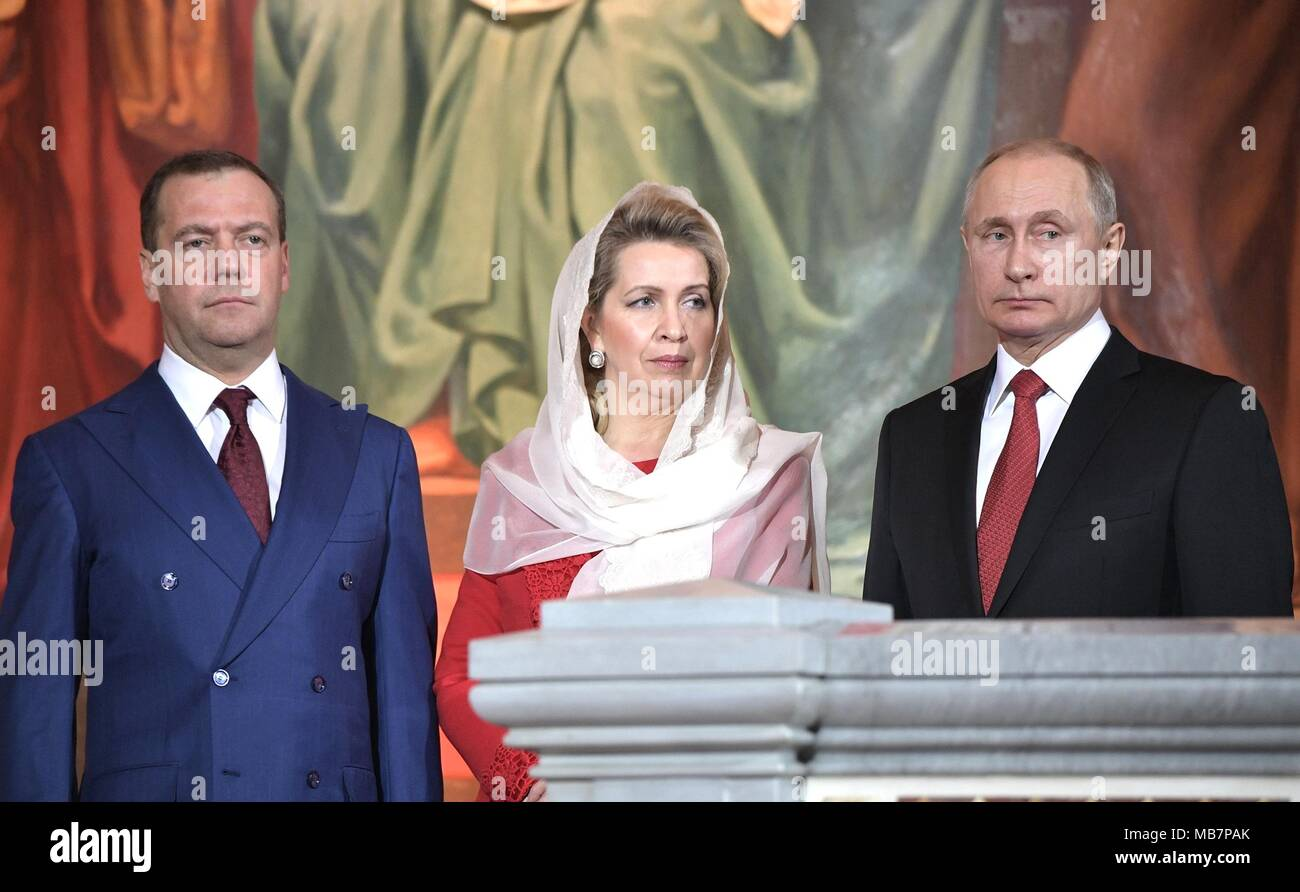 Russian President Vladimir Putin stands with Russian Prime Minister Dmitry Medvedev, left, and Svetlana Medvedev, center, during the Orthodox Easter service at the Christ the Savior Cathedral April 8, 2017 in Moscow, Russia. Credit: Planetpix/Alamy Live News - Stock Image