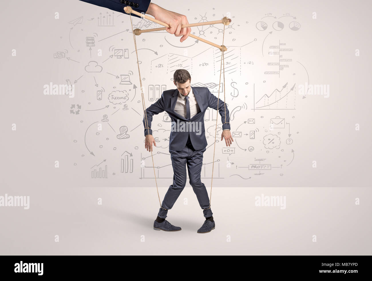 Little businessman controlled from above like a puppet concept  - Stock Image