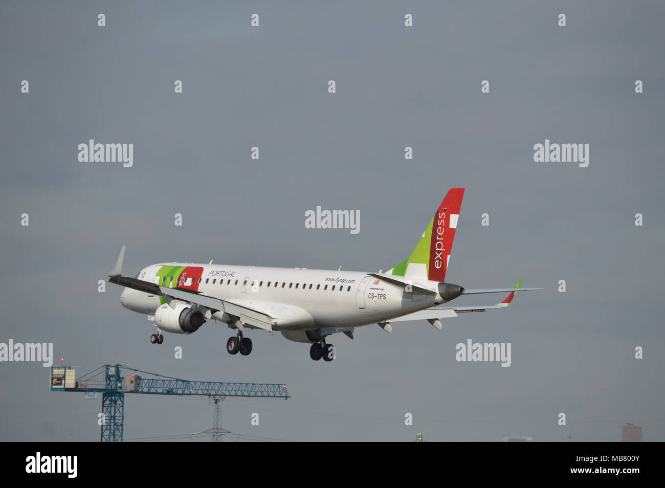 TAP Express Embraer 190 aircraft on approach to London City Airport - Stock Image