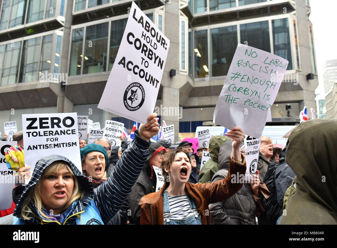 Protesters during the demonstration organised by the Campaign Against Antisemitism outside the Labour Party headquarters in central London, against alleged prejudice in the Labour Party, amid a row over the party's handling of claims of anti-semitism. - Stock Image
