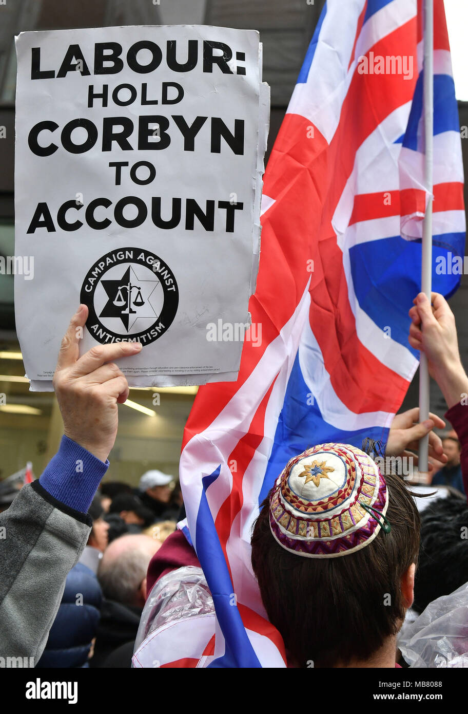 Protestors during the demonstration organised by the Campaign Against Antisemitism outside the Labour Party headquarters in central London, against alleged prejudice in the Labour Party, amid a row over the party's handling of claims of anti-semitism. - Stock Image