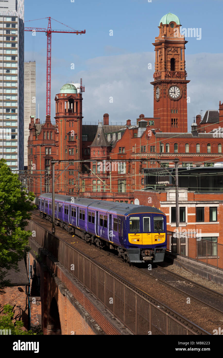 A Northern Rail class 319 electric train on the congested railway between Manchester Oxford Road an Piccadilly on Castlefield viaduct - Stock Image