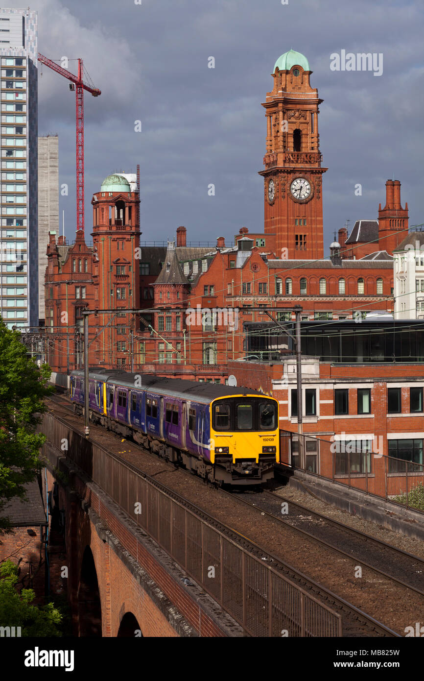 A Northern Rail class 150sprinter  train on the congested railway between Manchester Oxford Road an Piccadilly on Castlefield viaduct - Stock Image