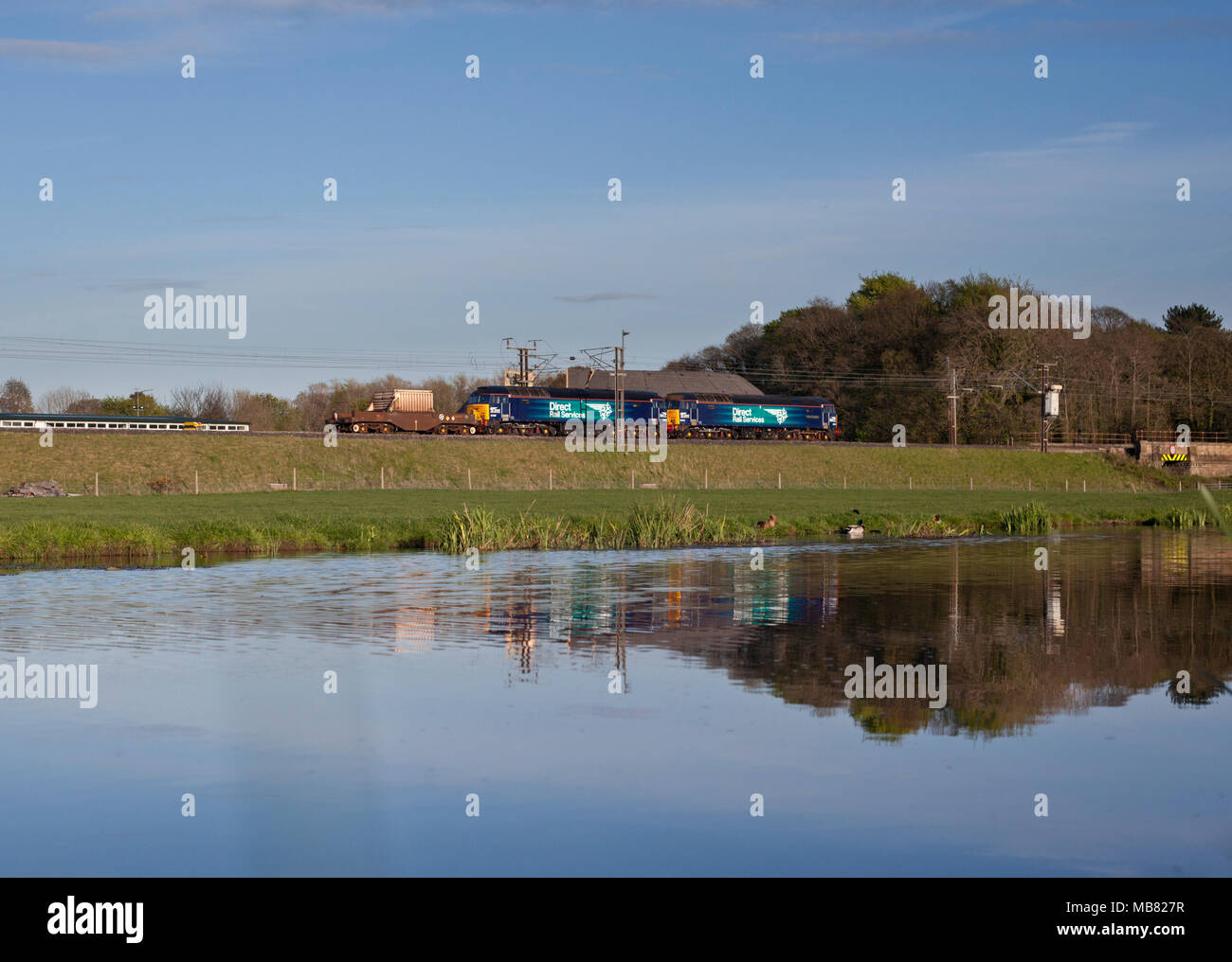 2 Direct rail Services class 57 locomotives on the west coast main line alongside a canal with the a nuclear flask - Stock Image