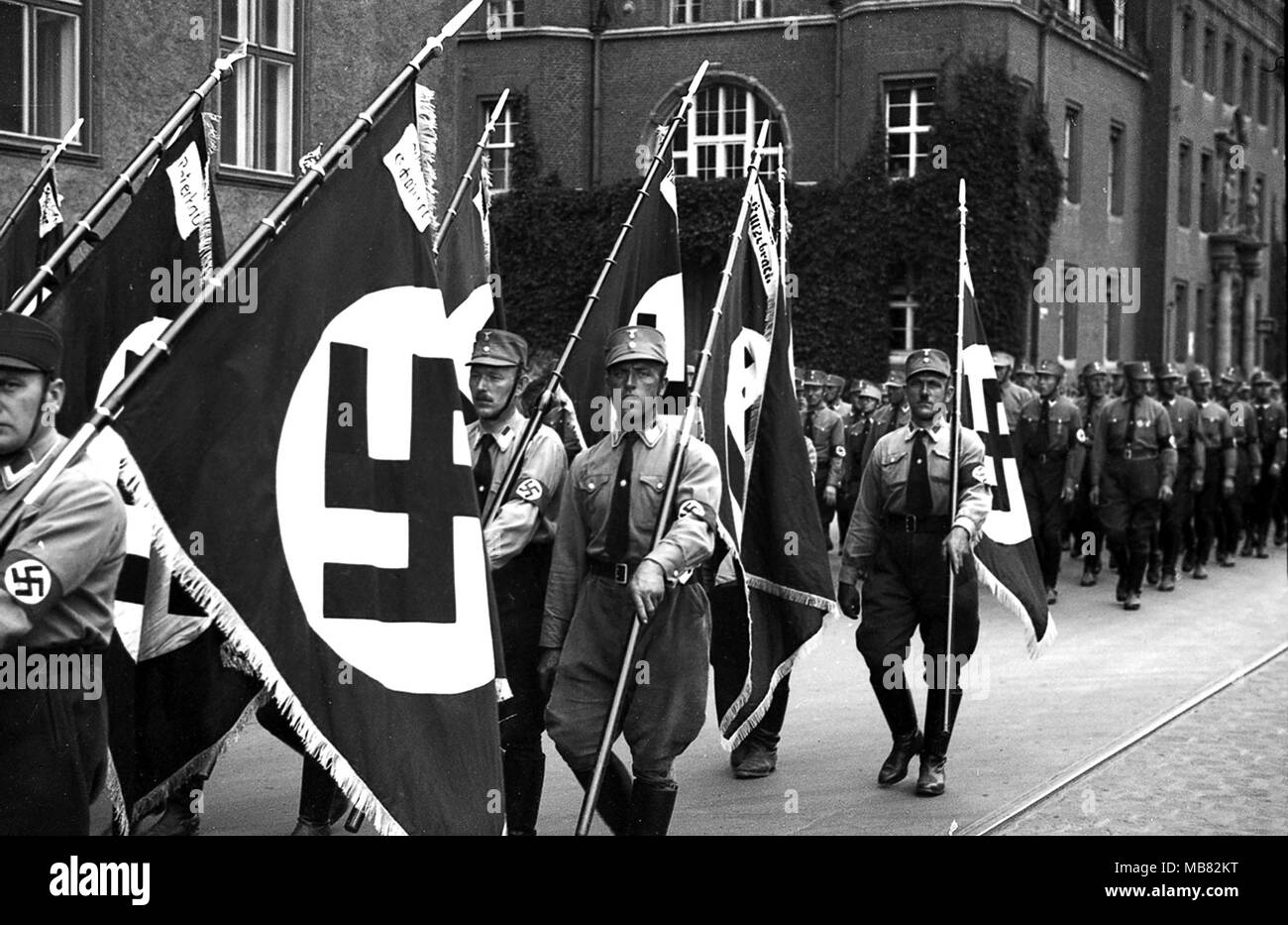 Sturmabteilung also called stormtoopers and Brownshirts carrying Swastika Flags in 1934 as they parade through Konigsberg in Germany. Konigsberg became Russian territory after the second world war and was renamed Kaliningrad. Stock Photo