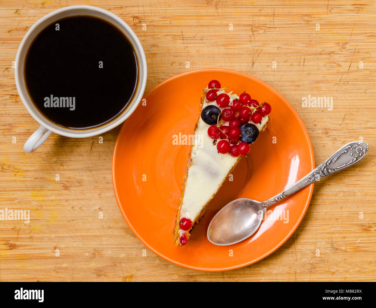 top view of composition with carrot cake and a cup of black coffee - Stock Image
