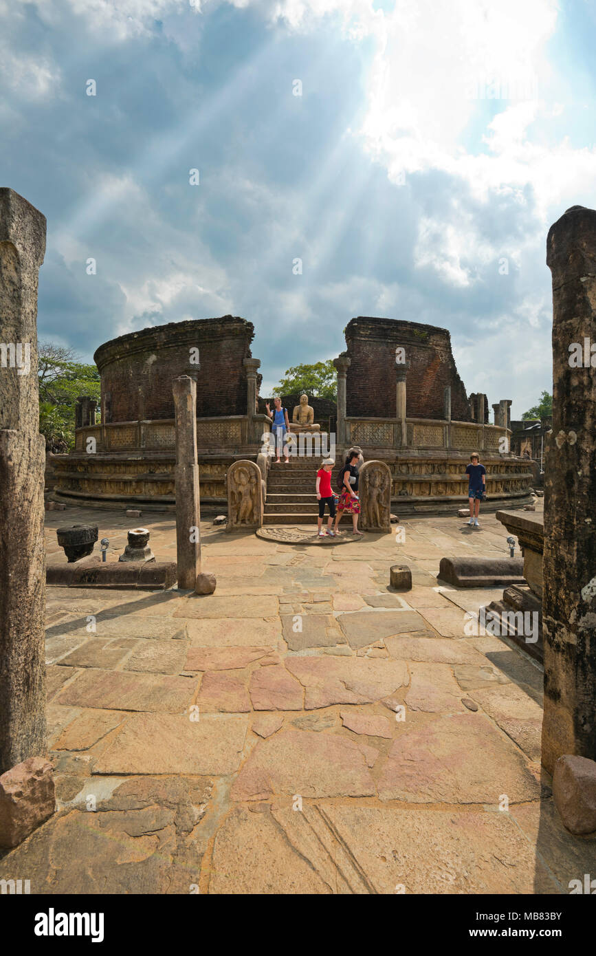 Vertical view of tourists walking around the Vatadage in Polonnaruwa, Sri Lanka. - Stock Image