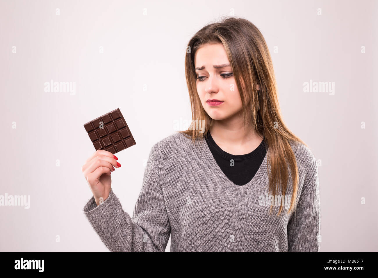Happy Young Beautiful Lady Eating Chocolate And Smiling Girl
