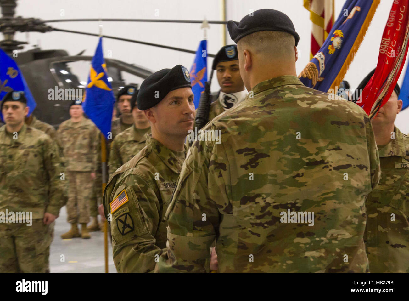 Lt  Col  James Scullion receives the battalion guidon during