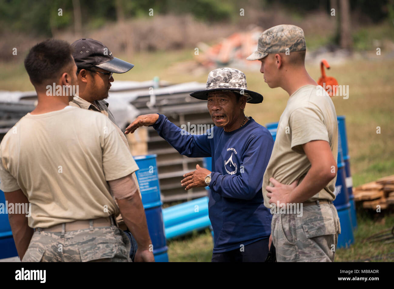 492cefb2a73ac A Royal Thai Air Force member speaks with U.S. Airmen from 18th Civil  Engineering Squadron