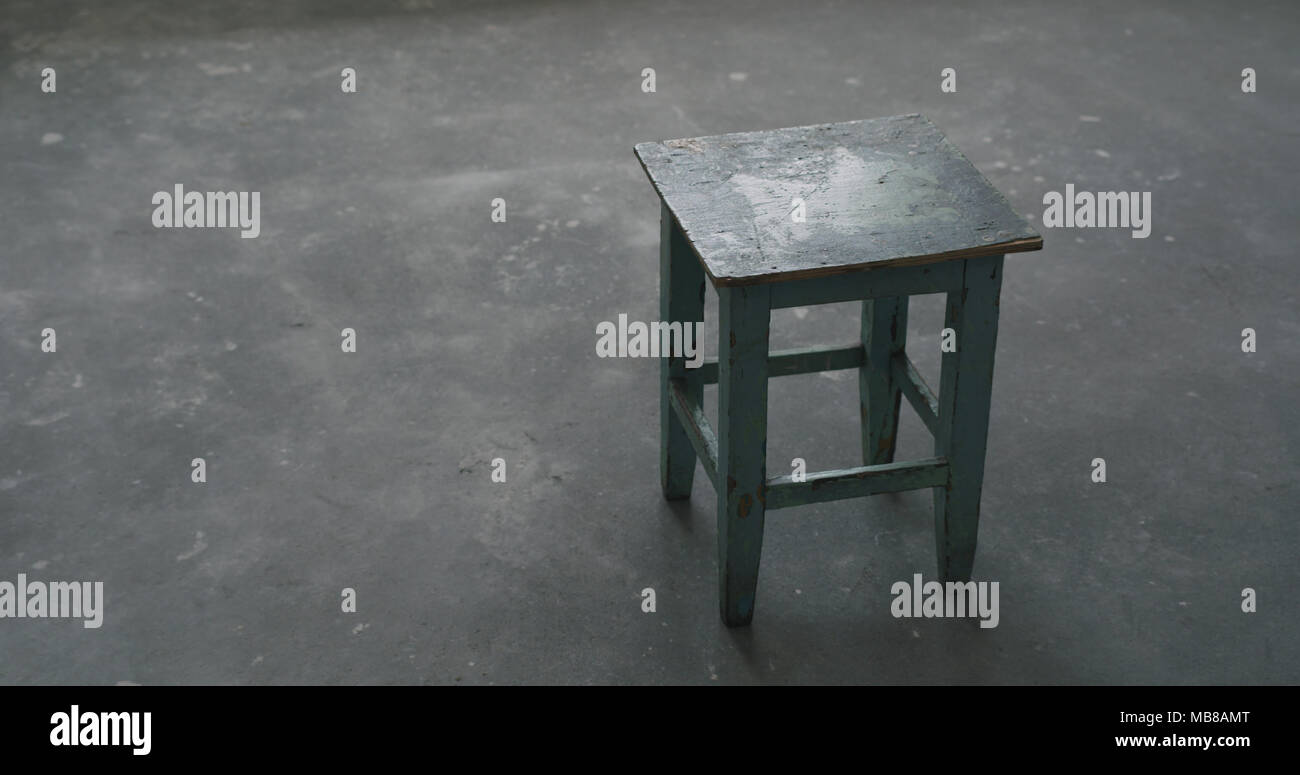 old stool in empty room during renovation, wide photo - Stock Image