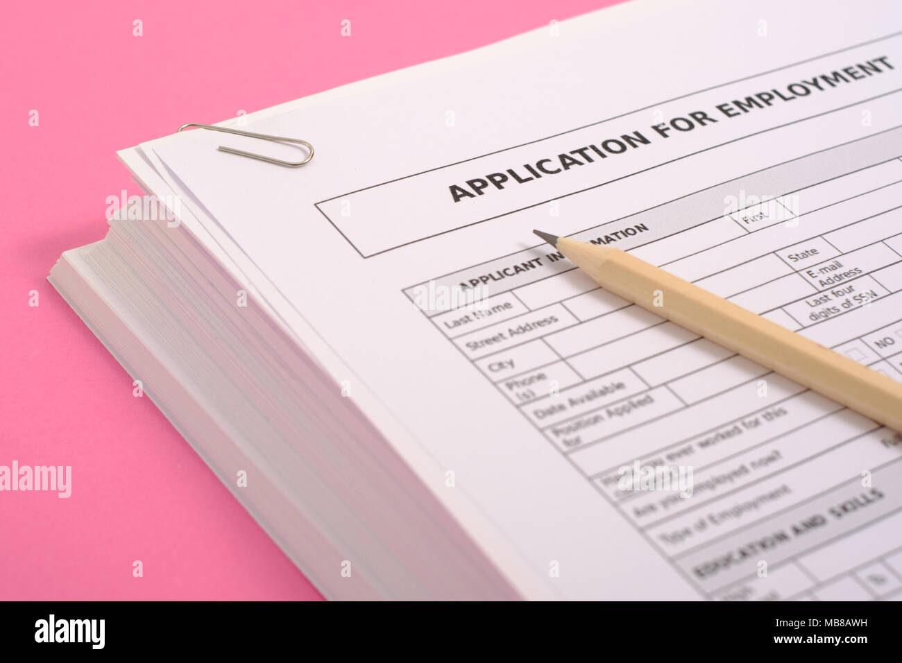 Equal opportunities career concept.Pile of cv isolated on pink background - Stock Image
