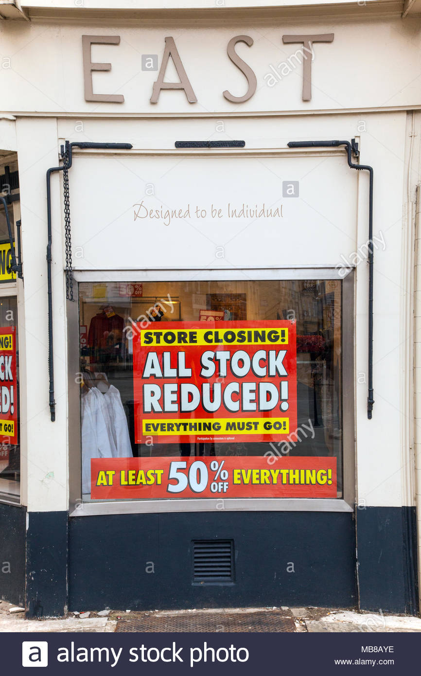 Women's high street fashion chain store East closing down sale due to going bankrupt with all stock reduced to 50% off in shop - Stock Image