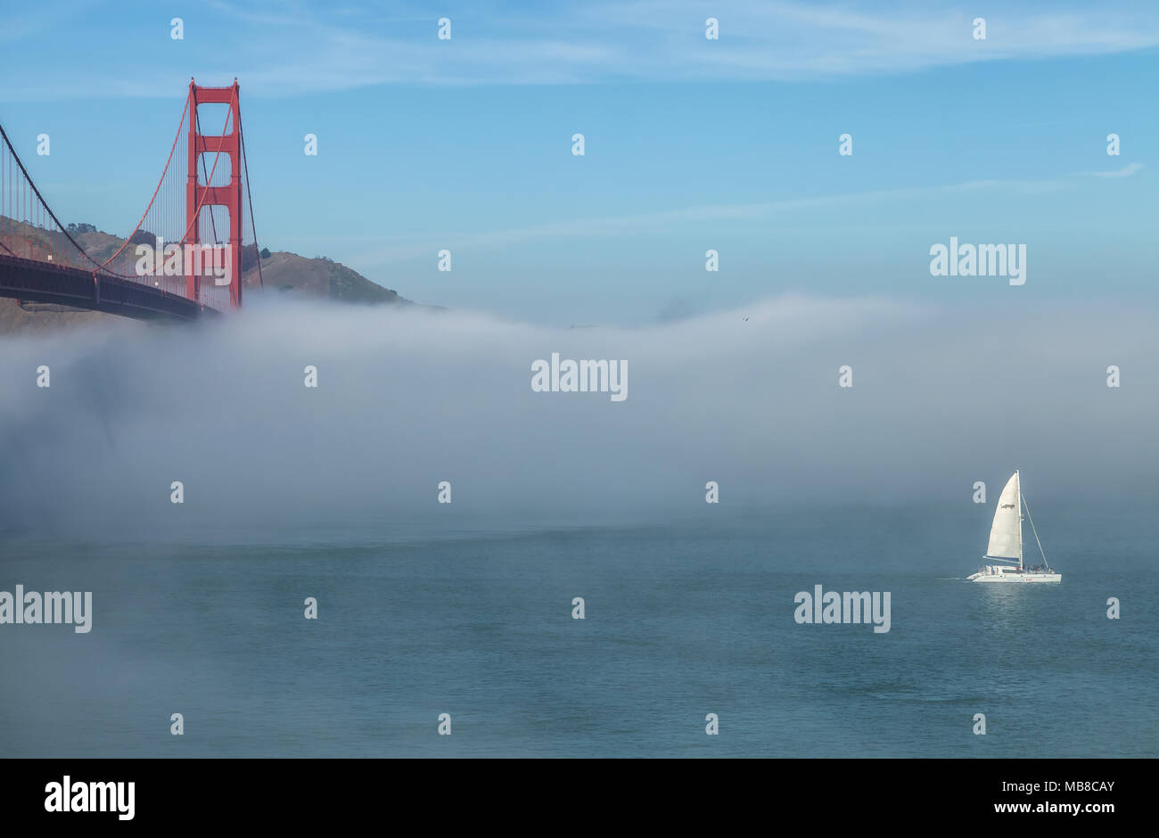 Fog formed under the Golden Gate Bridge and the San Francisco Bay, California, United States, on an early spring morning. - Stock Image