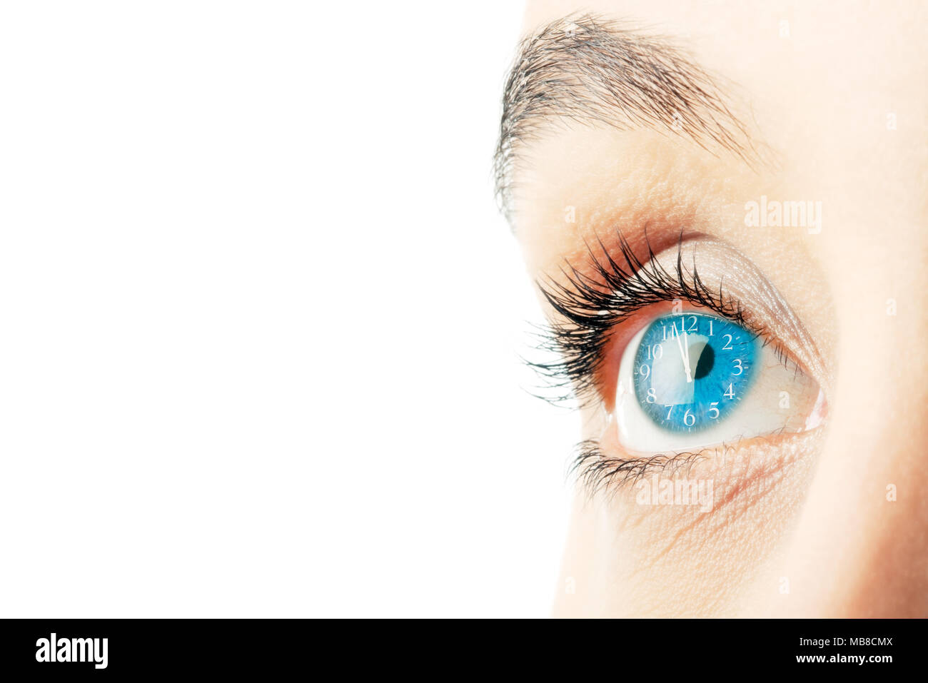 a91c9a415dc5 Close up of woman's eye with clock face superimposed - Stock Image