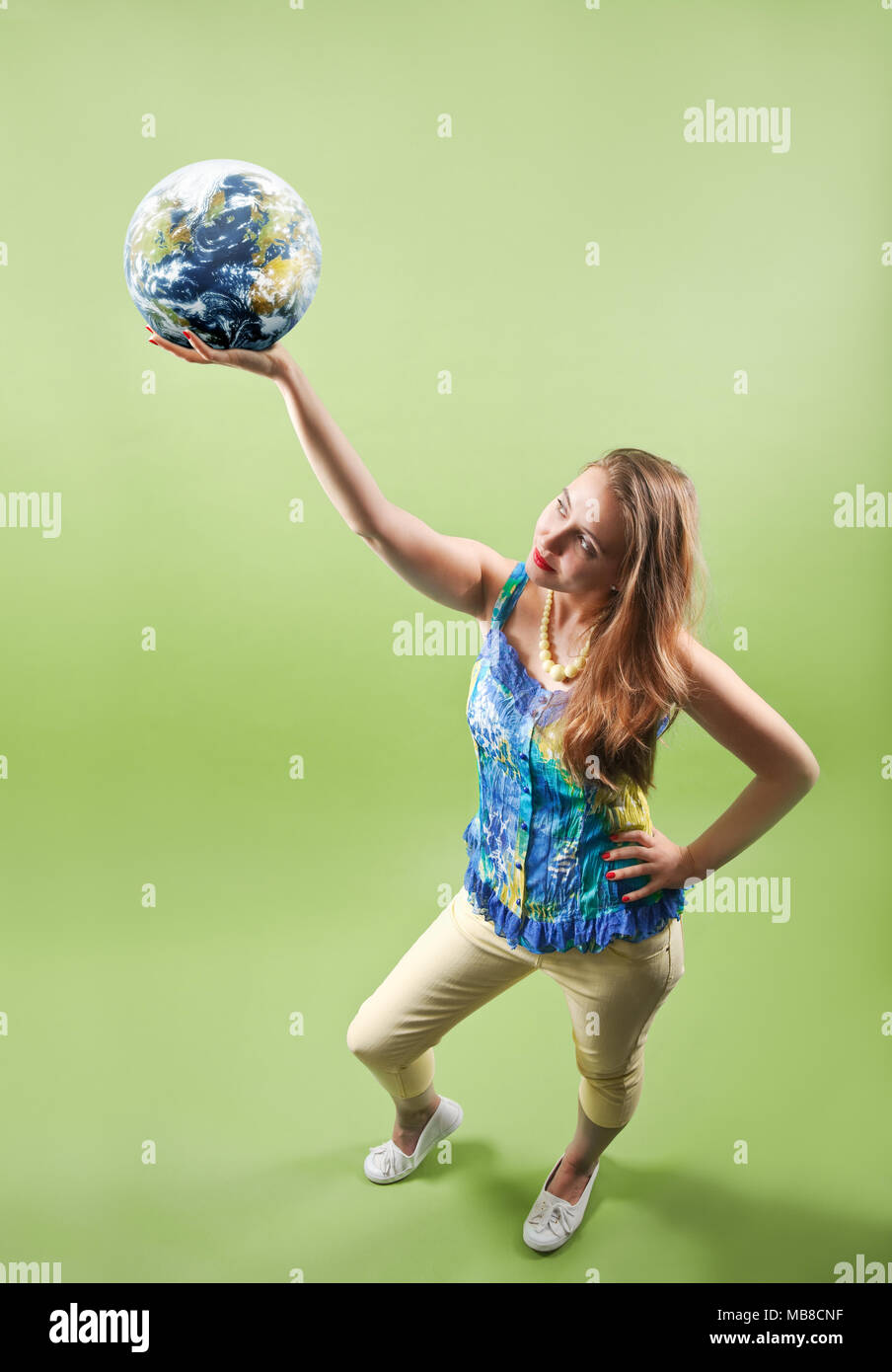 Woman holding the world in her hand - Stock Image
