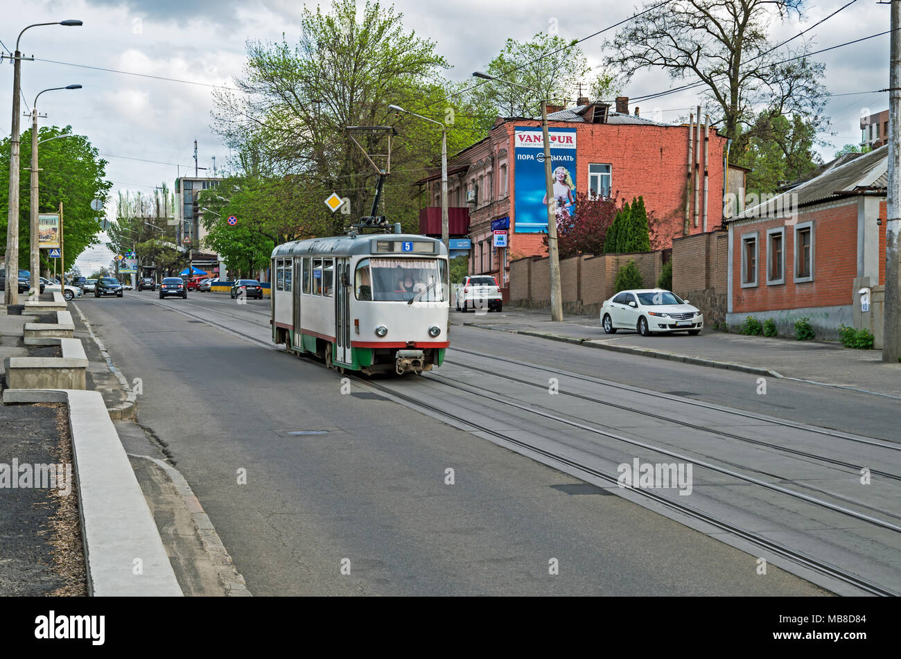 Dnipro, Ukraine - April 19, 2016: Tramway traffic on the city street in middle of spring early in the evening - Stock Image