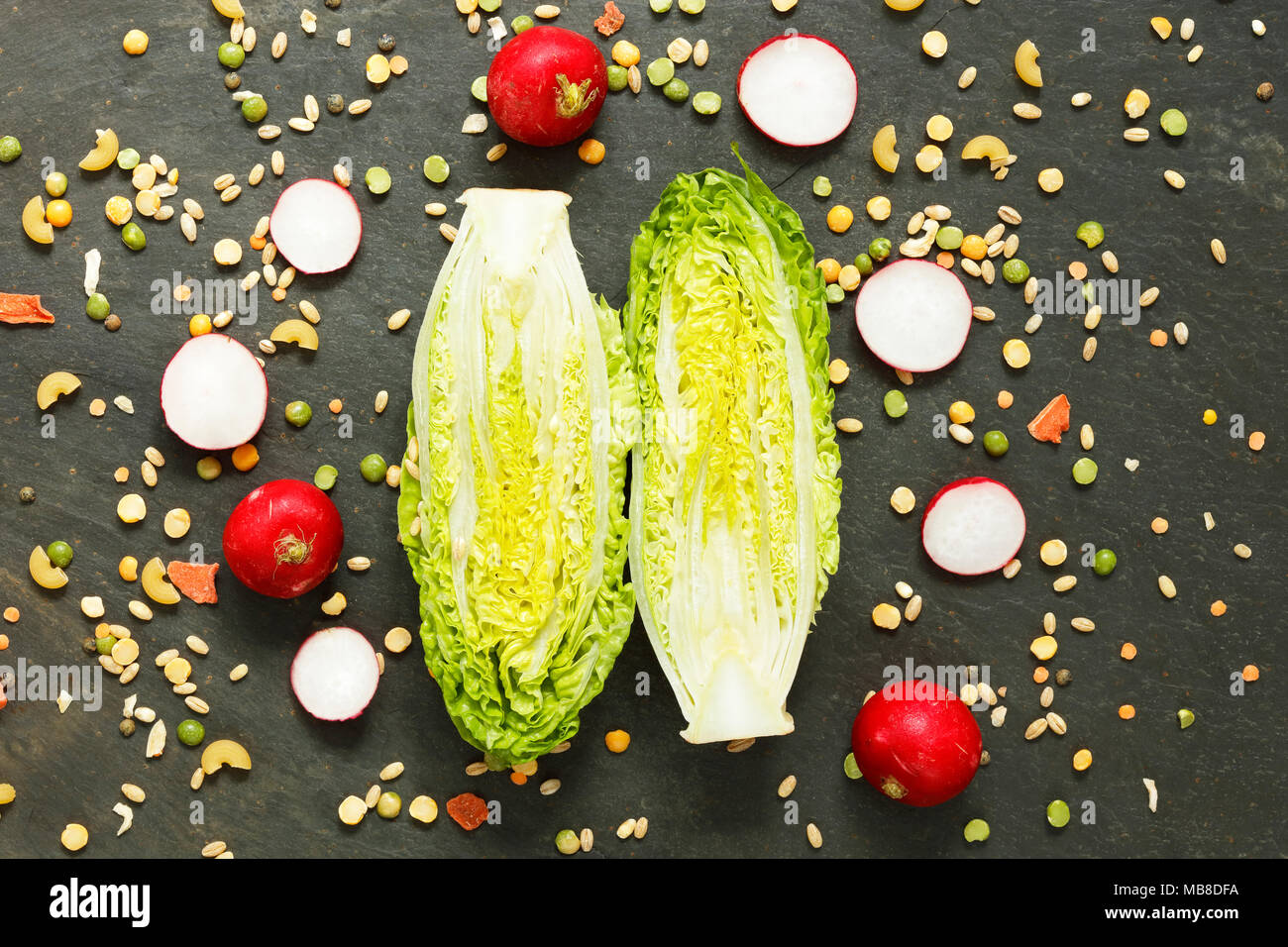 Gem lettuce, radish and dried vegetable ingredients for vegan soup or stew - Stock Image