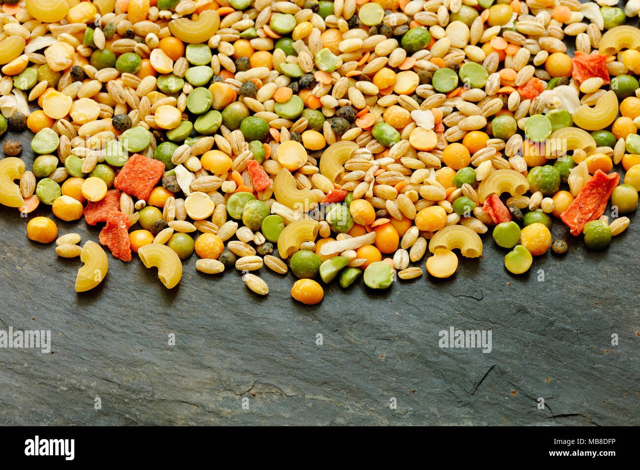 Mixed dried vegetables and pasta for vegan stew or soup with copy space - Stock Image