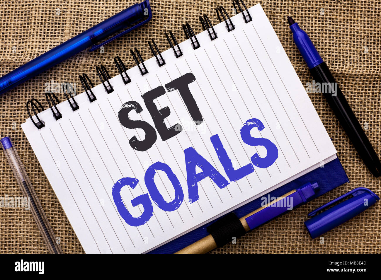 Conceptual hand writing showing Set Goals. Business photo showcasing Target Planning Vision Dreams Goal Idea Aim Target Motivation written Notebook Bo - Stock Image