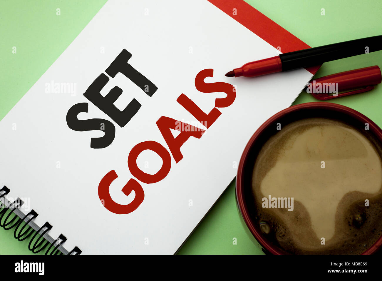 Handwriting text writing Set Goals. Concept meaning Target Planning Vision Dreams Goal Idea Aim Target Motivation written Notebook Book the plain back - Stock Image