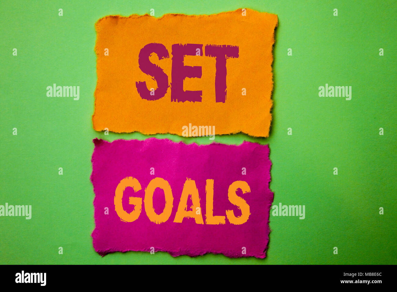 Handwriting text Set Goals. Concept meaning Target Planning Vision Dreams Goal Idea Aim Target Motivation written Tear Papers the Green background. - Stock Image