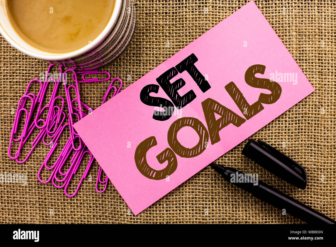 Handwriting text writing Set Goals. Concept meaning Target Planning Vision Dreams Goal Idea Aim Target Motivation written Pink Sticky Note Paper the j - Stock Image