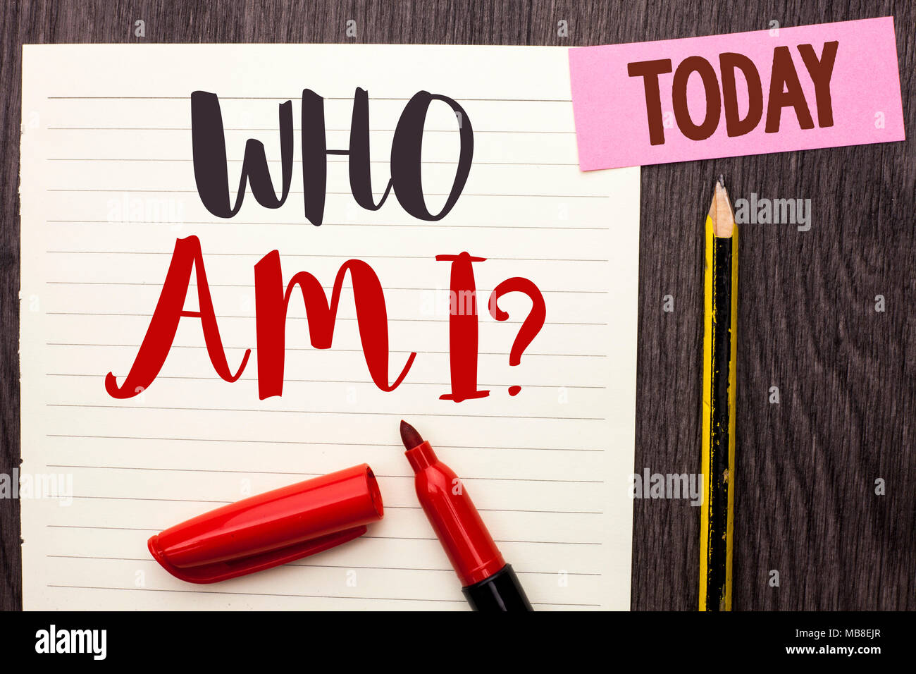 Writing note showing  Who Am I Question. Business photo showcasing Question Asked Identity Thinking Doubt Psycology Mystery written on Notebook Paper on the Wooden background Today Marker Pencil. - Stock Image