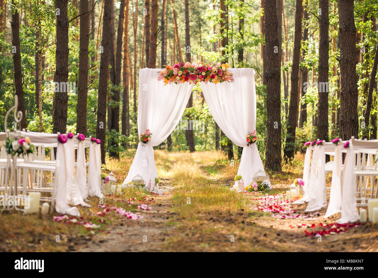 Beautiful romantic festive place made with wooden square and floral beautiful romantic festive place made with wooden square and floral roses decorations for outside wedding ceremony in green park wedding settings at junglespirit Gallery