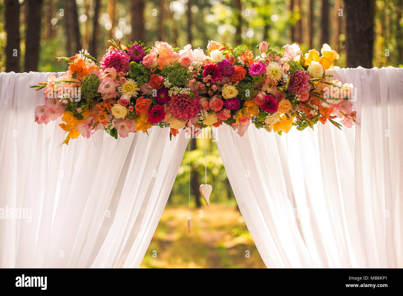 Floral wedding decorations for beautiful romantic wedding ceremony floral wedding decorations for beautiful romantic wedding ceremony outside at sunny forest horizontal color photography junglespirit Gallery