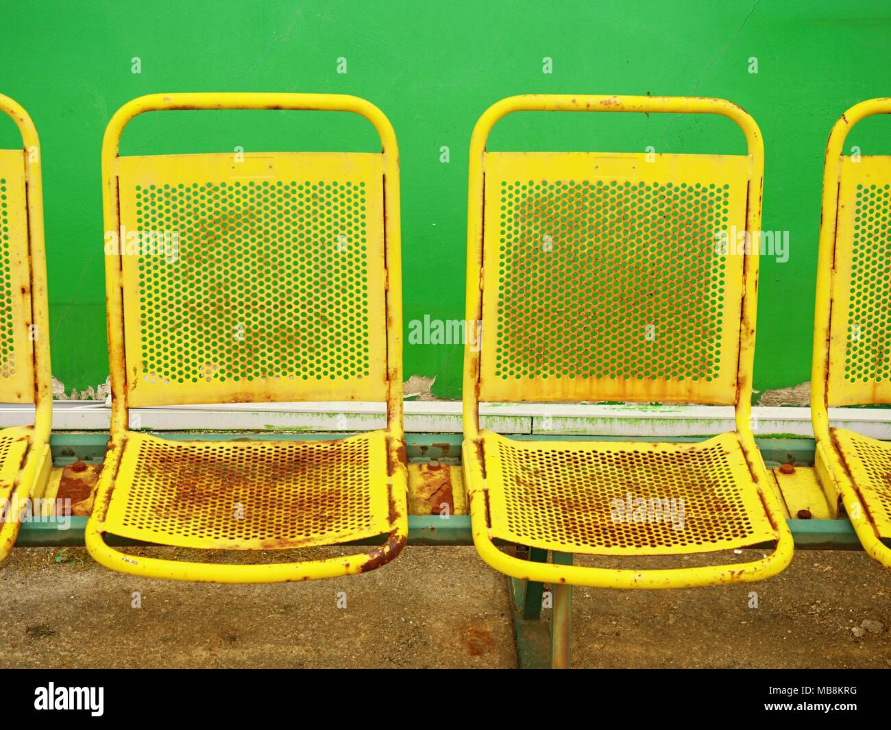 Outstanding Old Yellow Rusty Metal Seats On Outdoor Stadium Players Dailytribune Chair Design For Home Dailytribuneorg