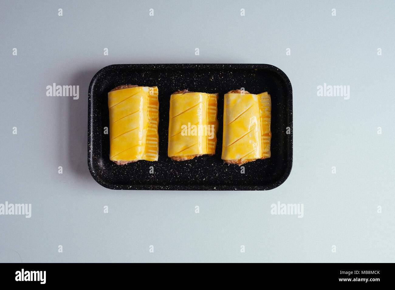 Sausage Roll ready for Baking - Stock Image
