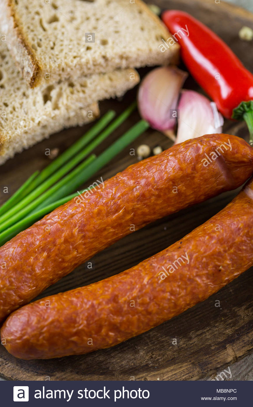 Assorted smoked and cured spicy sausages - Stock Image