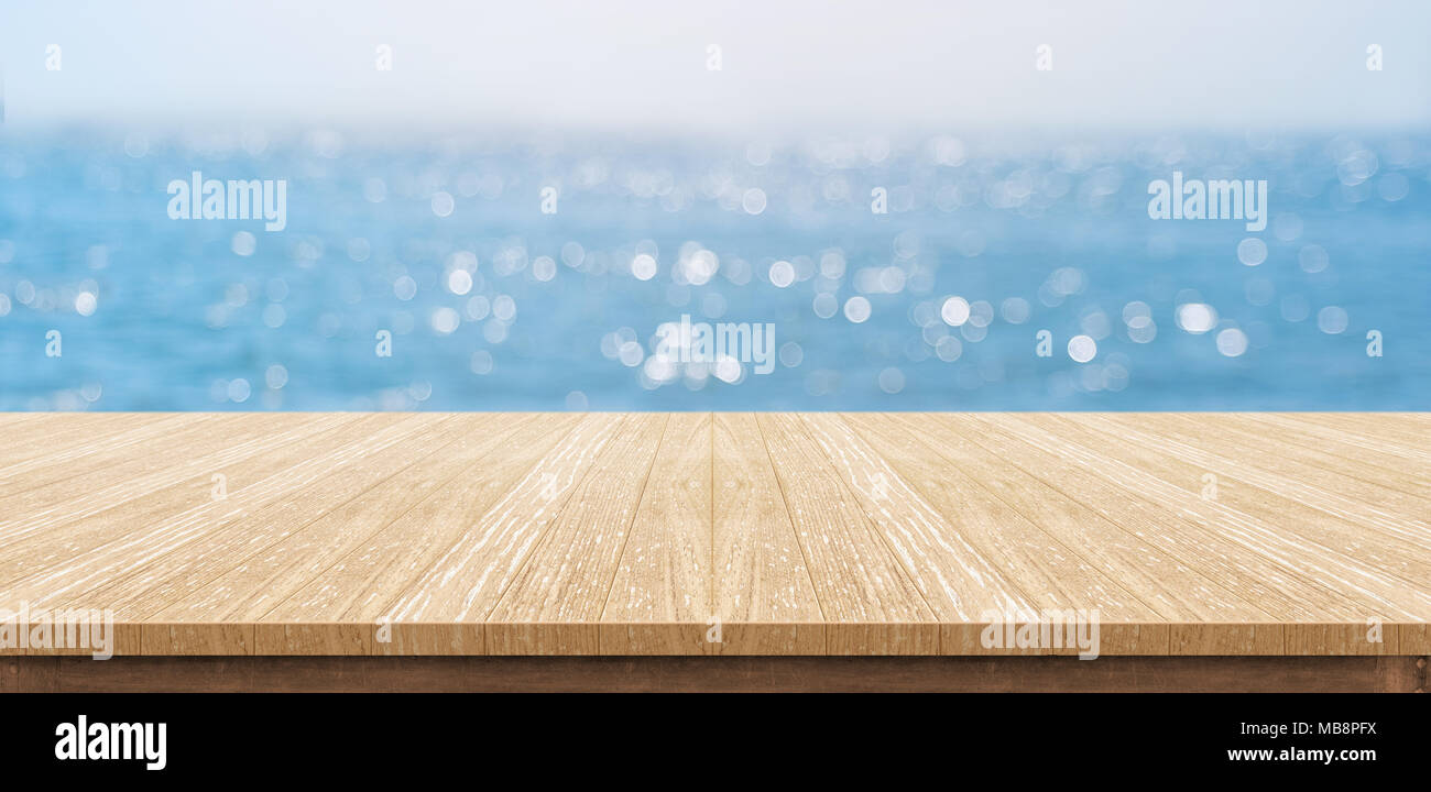 table top background brown empty plank wood table top with blur blue sky and sea boekh backgroundmock up template for display or montage of product content use as banner in