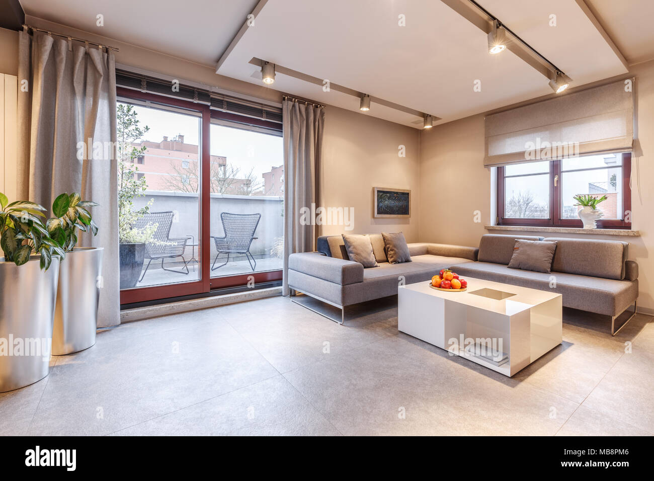 Spacious Modern And Brown Living Room Interior With A Grey