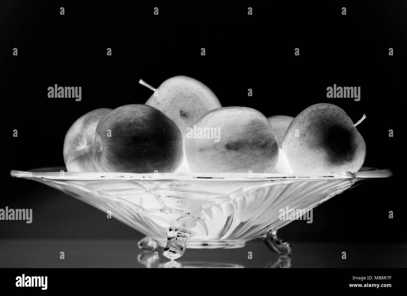 Glass bowl with apples - Stock Image