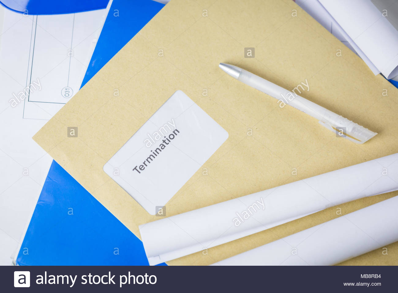 Termination notice lying on an architects desk - Stock Image