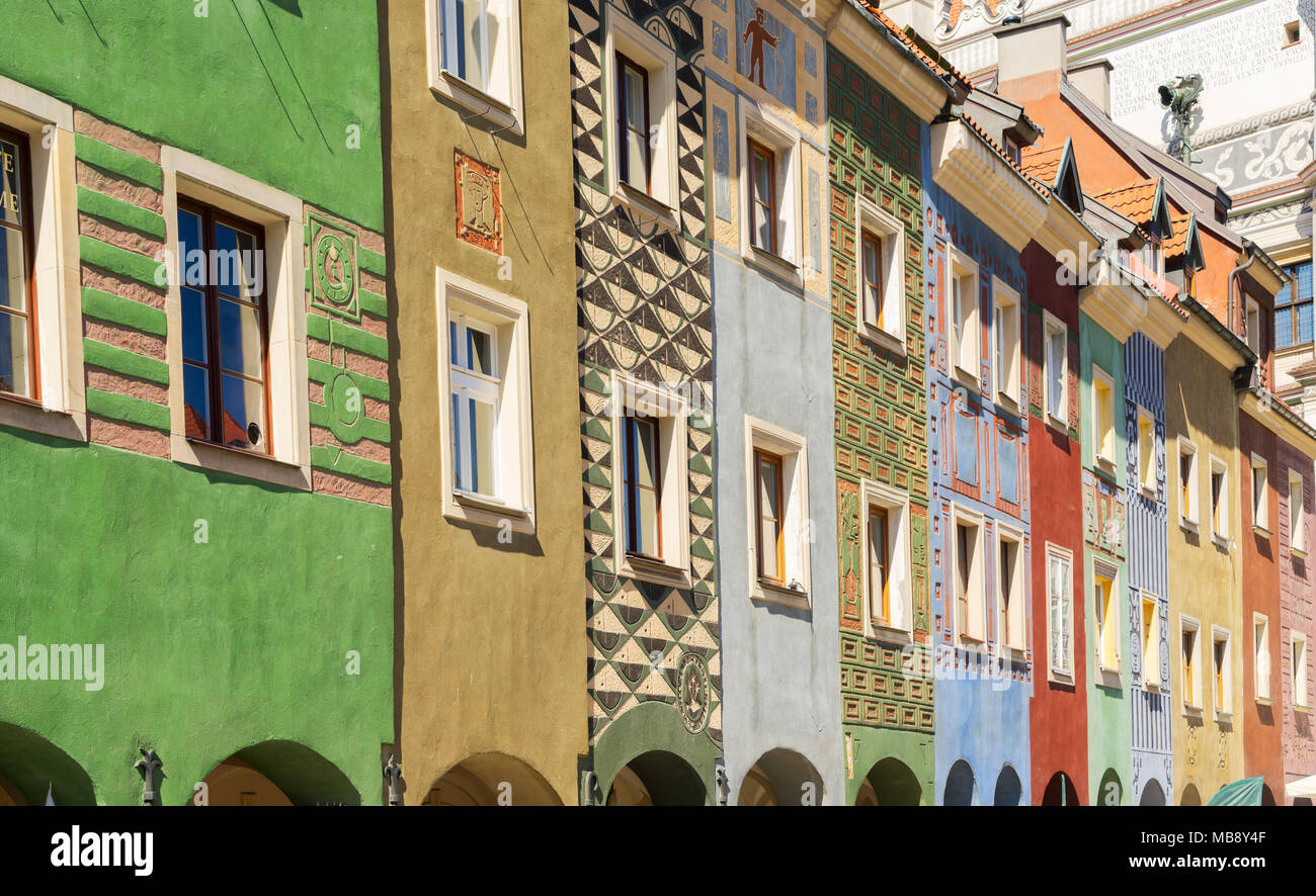 facades of colorful crooked medieval houses on the central market square in Poznan, Poland Stock Photo