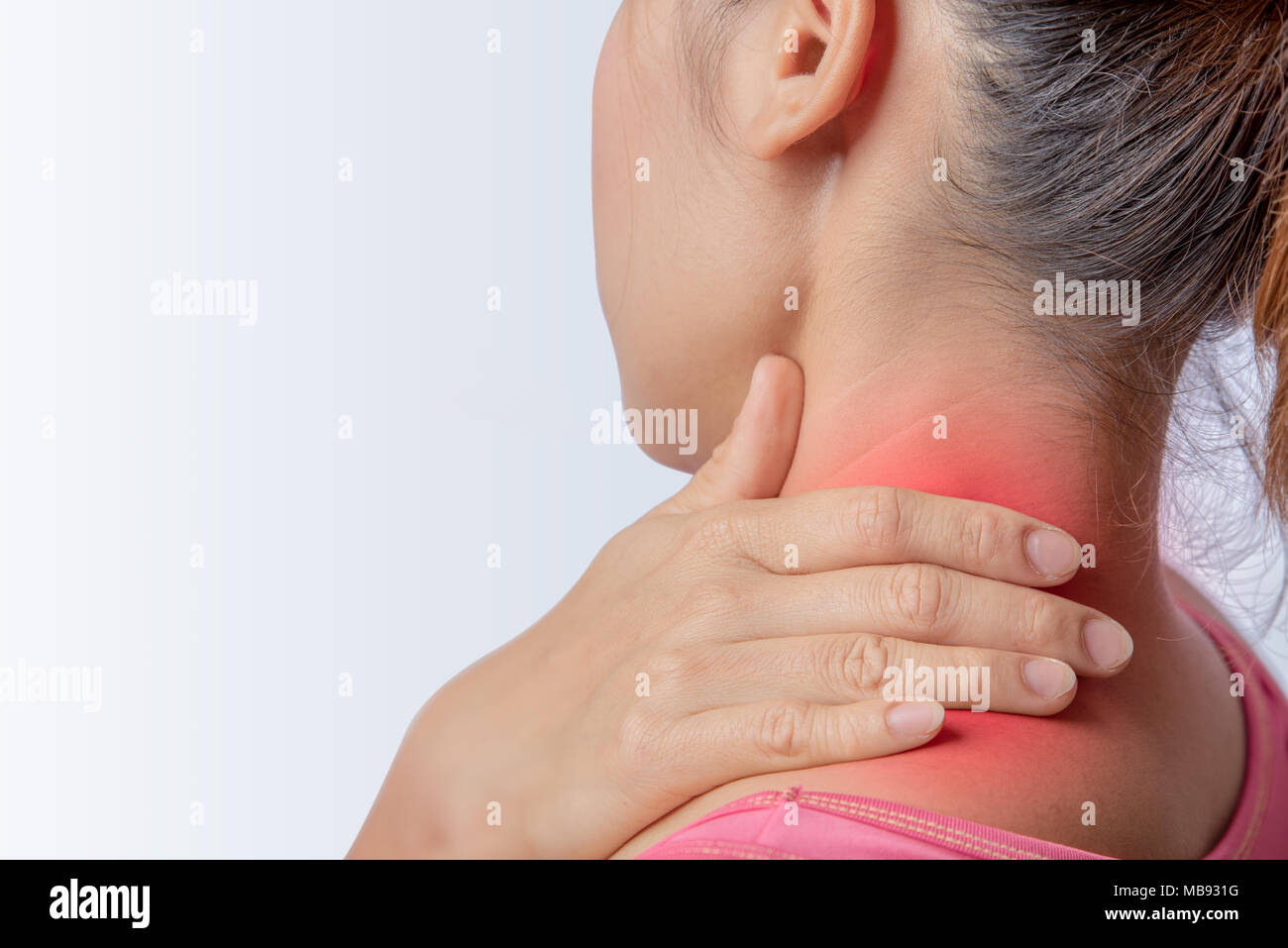 woman pain at trapezius muscle and holding right hand on muscle, swelling and inflammation of left rotator cuff muscle - Stock Image