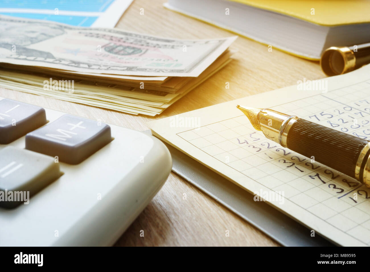home budget managing dollar bills calculator and note with monthly