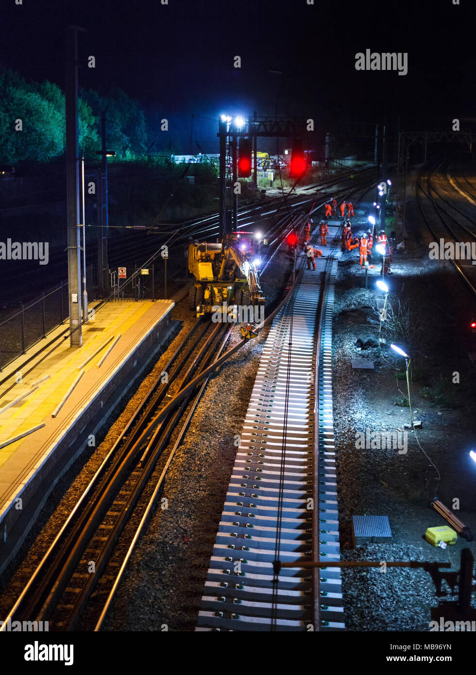 Network Rail contractors carrying out night time track renewal at Lancaster  on the west coast main line at 0500 on a Sunday morning - Stock Image