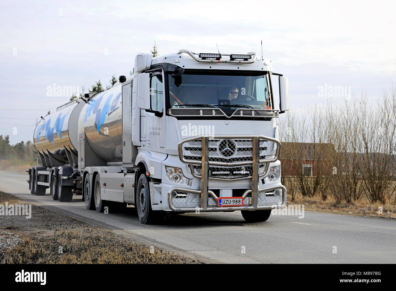 SALO, FINLAND - APRIL 8, 2018: Mercedes-Benz Actros 2551 tank truck of MJJ  Kuljetus Oy transports Valio Milk along road at spring.