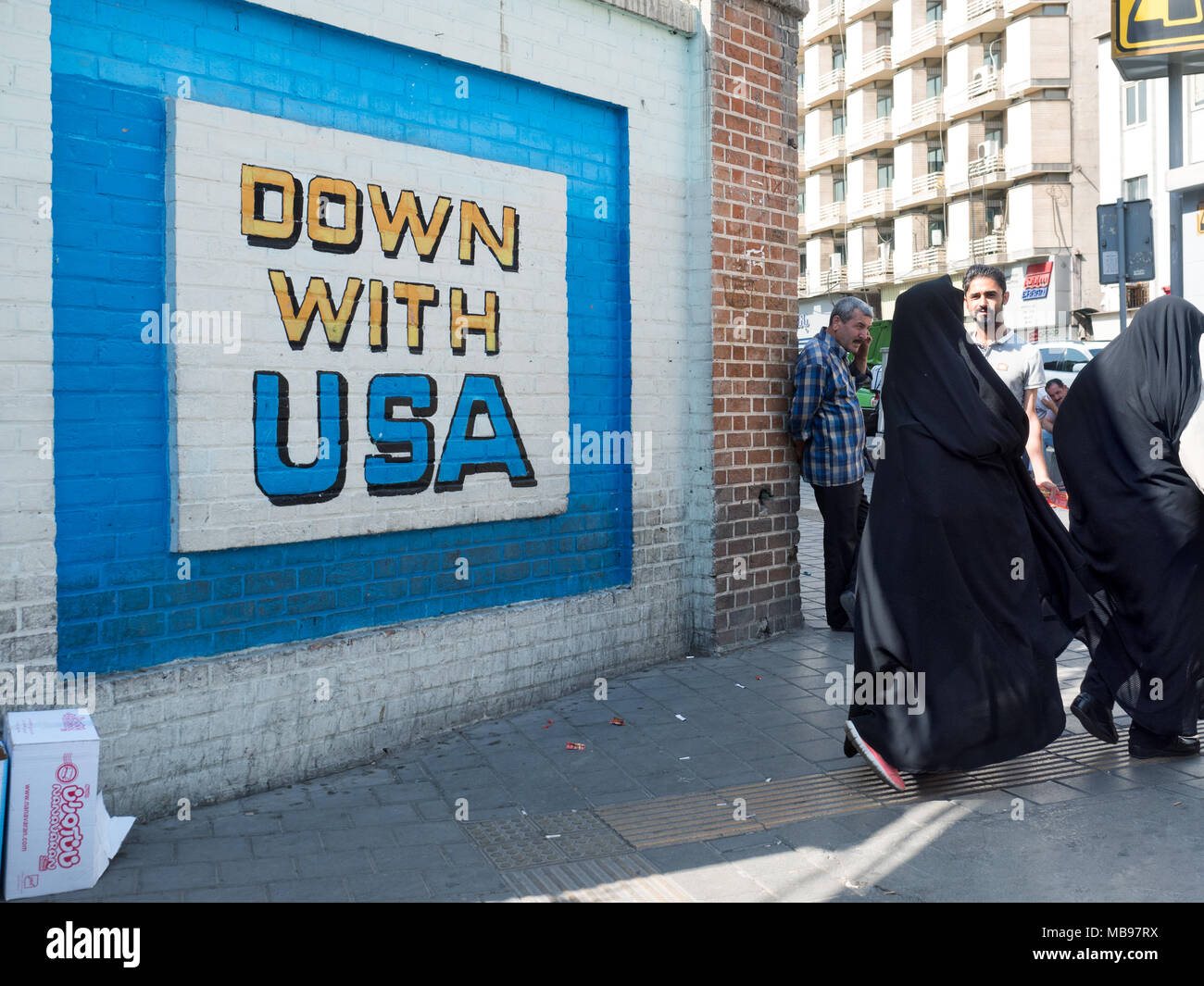 Tehran, Iran - July 16, 2016 : propaganda mural against USA on the wall of former US embassy - Stock Image
