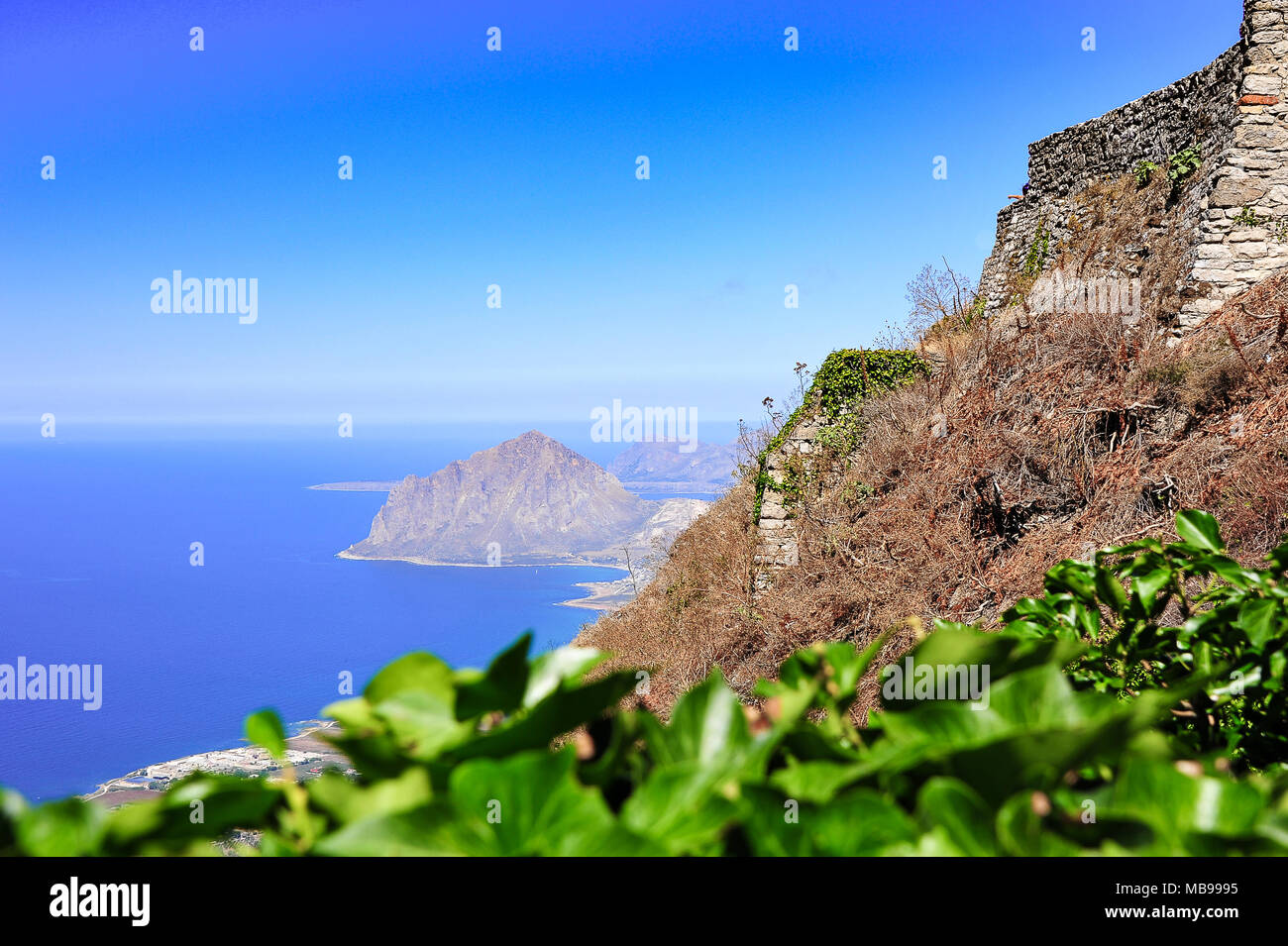 Aerial view from Erice near Trapani (Sicily) to Riserva Naturale Orientata Monte Cofano. Ancient hilltop fortress keeps watch over the Tyrrhenian Sea - Stock Image